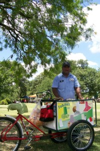 A photo of a paleta (popsicle) vendor in San Pedro Springs Park in San Antonio, Texas.
