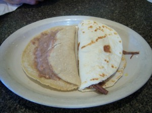 Photo of Bean on Corn Tortilla and Brisket on Flour Tortilla Breakfast Tacos.