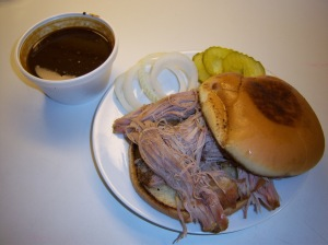 Photo of Augie's Barbed Wire Smokehouse Pulled-Pork Sandwich.