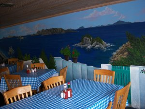 Photo of Greek islands mural on the wall of Demo's Greek Food.