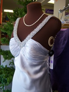 Photo of a silver holiday evening gown for sale at Goodwill.