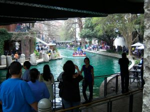 Photo of San Antonio River dyed green for St. Patrick's Day.